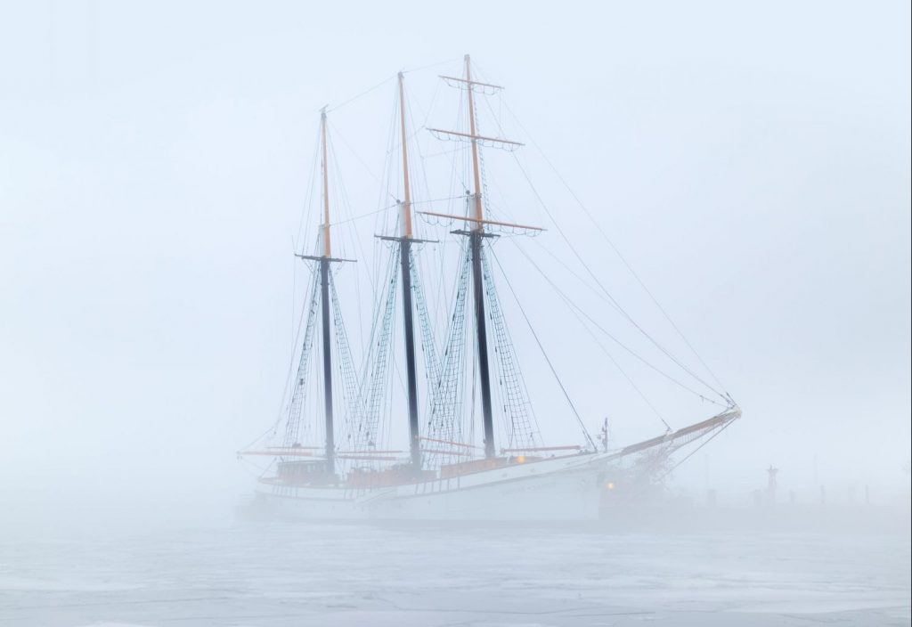 Ship in fog symbolizing COVID health decline