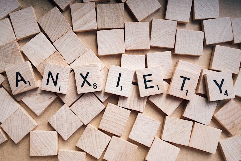 anxiety spelled with scrabble tiles