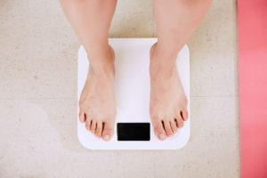 weighing part of achieving healthy weight loss goals