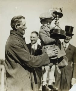 kid holding trophy